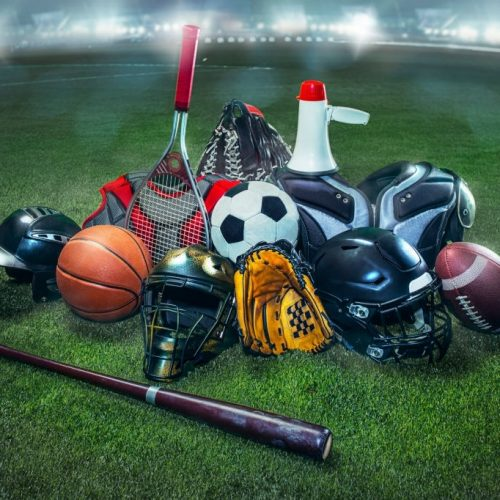 Sports balls on the field with yard line. Soccer ball, American football and Baseball in yellow glove on green grass. Outdoors. Green grass of stadium. sports equipment concept. 3D model of the stadium was created by me (the author)