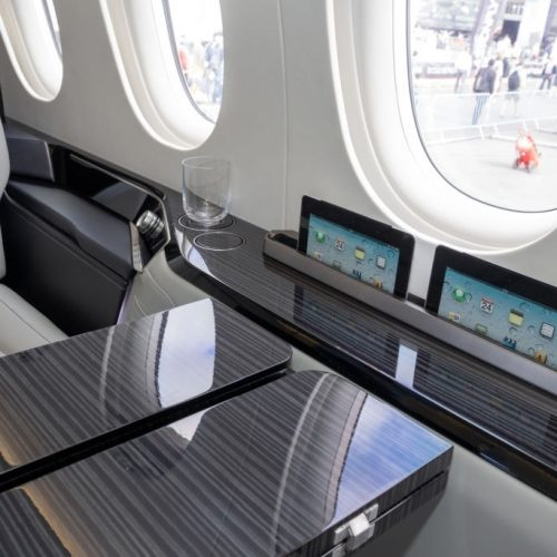Modern interior of the Dassault Falcon business jet at Le Bourget airport. June 23, 2017.