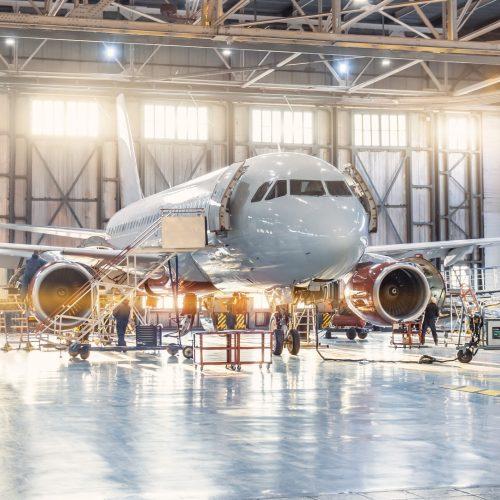 view-inside-the-aviation-hangar-the-airplane-aerospace-mechanic-working-around-the-service-getty